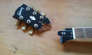 A repair job I often perform: Gluing broken headstocks. Usually, the head is still hanging on to the neck, here it came off.